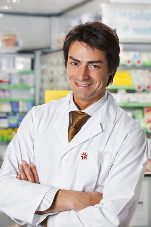 portrait of mid adult pharmacist looking at camera photo