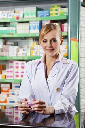 portrait of young adult pharmacist looking at camera photo