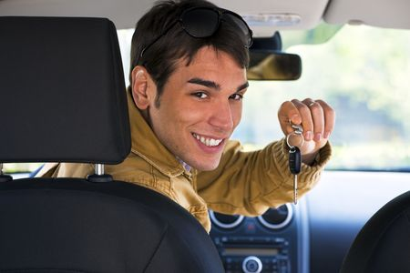 rear view of man holding keys to new car Stock Photo - 4669279