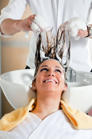 portrait of young woman in hair salon Stock Photo
