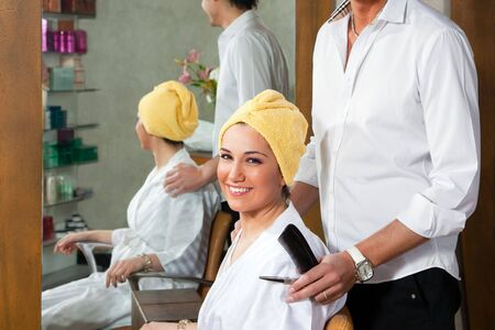 coiffeur: hairstylist and customer looking at camera and smiling Stock Photo