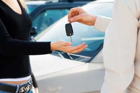 cropped view of man in car dealership giving car keys to client Stock Photo - 4692730