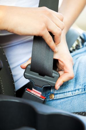 close up of female fastening safety belt in car Stock Photo