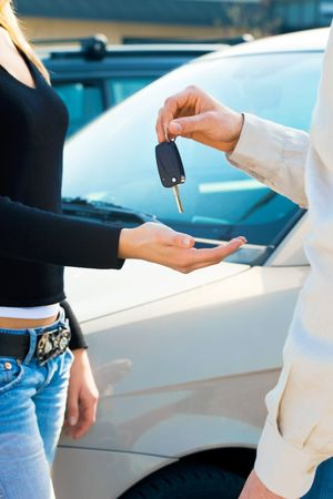 cropped view of man in car dealership giving car keys to client Stock Photo - 4719744