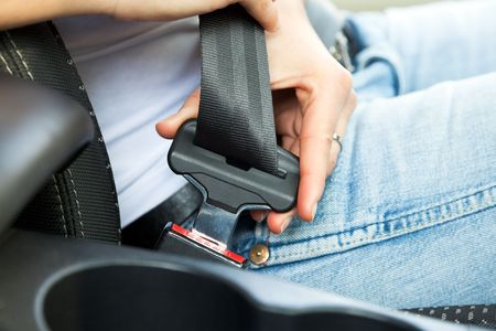 safety belt: close up of female fastening safety belt in car Stock Photo