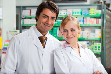 pharmacist: portrait of two pharmacists looking at camera and smiling