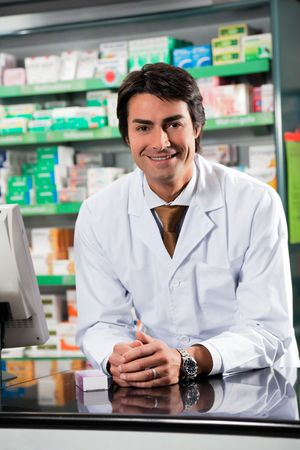 portrait of mid adult pharmacist looking at camera