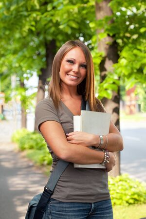 female college student looking at camera and smiling outdoors Stock Photo - 4761683