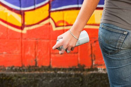 close up of young graffiti artist holding spray can. Copy space Stock Photo - 4780705
