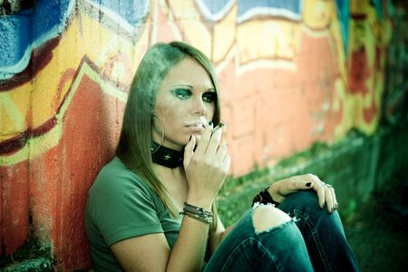 portrait of young female smoking a joint. Copy space