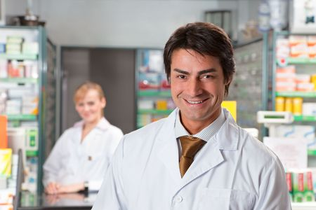 pharmacist: portrait of male pharmacist looking at camera and smiling Stock Photo