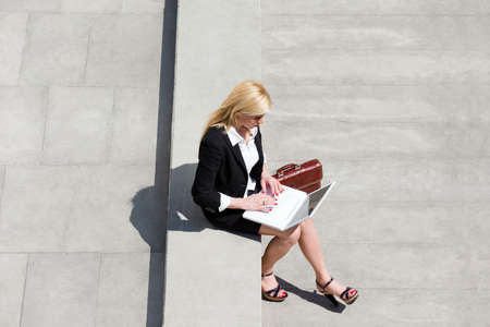 high angle: high angle view of businesswoman using computer laptop outdoors