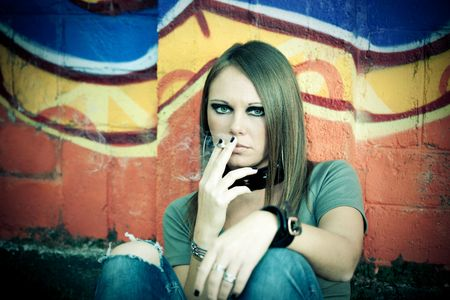 smoking marijuana: portrait of young female smoking a marijuana.