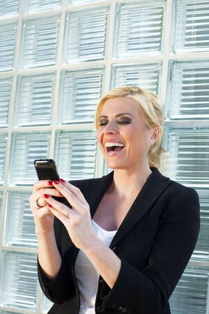 mid adult businesswoman reading phone message on smartphone. Copy space Stock Photo - 4837374