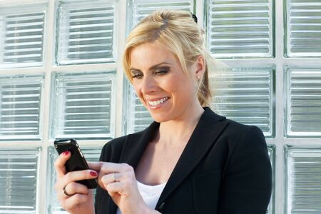 mid adult businesswoman reading phone message on smartphone. Stock Photo - 4869120