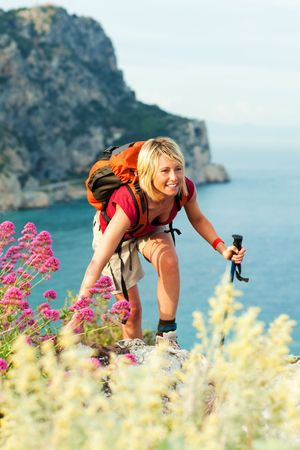 young blonde woman hiking and smiling. Copy space Stock Photo - 4929165