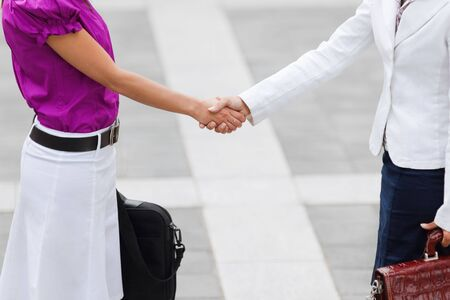 cropped view of two business women shaking hands. Copy space photo