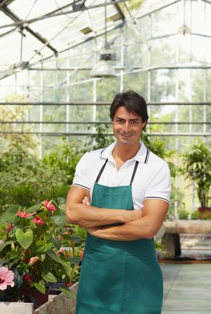 portrait of male florist looking at camera with arms folded