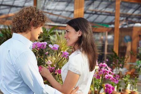 mid adult couple shopping in garden center photo