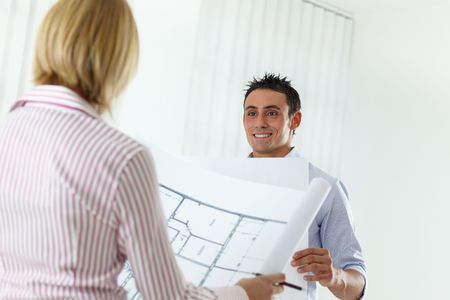 two architects examining blueprint indoors. Copy space Stock Photo - 5144236