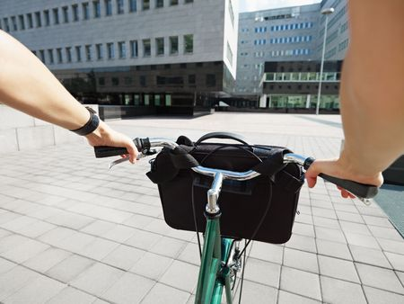 Cropped view of businesswoman going to work by bike Stock Photo - 5350973