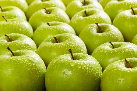 large group of granny smith apples in a row. Selective focus photo