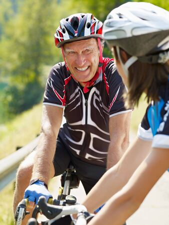 Senior man and young woman on road bike Stock Photo - 5532659