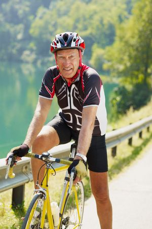 senior man on road bike, looking at camera. Stock Photo - 5557951