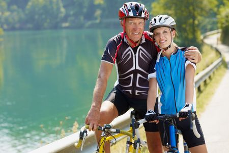 Senior man and young woman on road bike. Copy space Stock Photo - 5619258