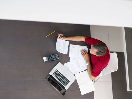 Senior man checking home finances. High angle view, copy space Stock Photo - 5652346