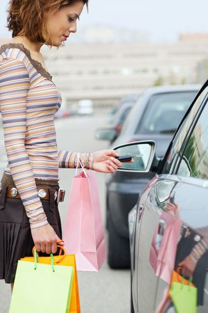 retail therapy: woman with shopping bags holding car keys Stock Photo