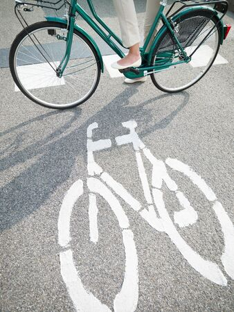 one lane street sign: cropped view of woman commuting on bicycle
