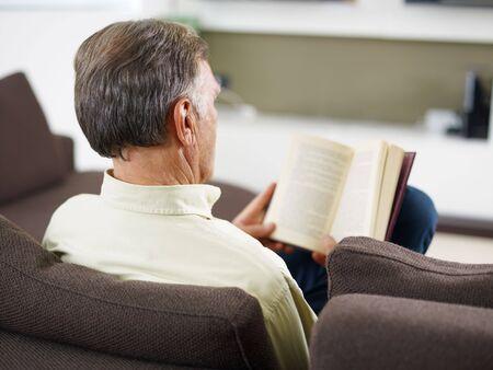 senior man reading book at home Stock Photo - 5695004