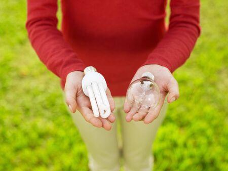 Woman holding light bulbs. Selective focus, high angle view Stock Photo - 5707363