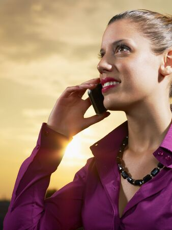 business woman talking on mobile phone outdoors photo