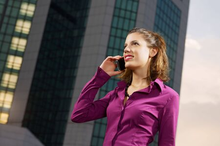 business woman talking on mobile phone outdoors Stock Photo - 5707364