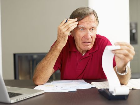 taxes budgeting: Senior man worried about his home finances. Copy space Stock Photo