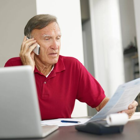taxes budgeting: Senior man checking home finances. Copy space