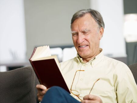 senior man reading book at home. Copy space Stock Photo - 5786444