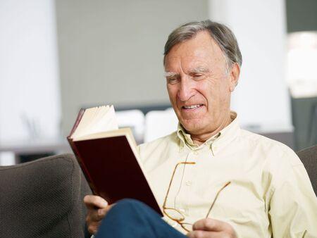 senior man reading book at home. Copy space Stock Photo - 5786444