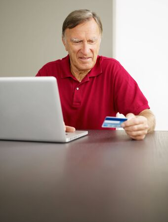 senior man with laptop computer and credit card. Copy space photo