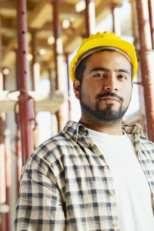 Portrait of latin american construction worker looking at camera. Copy space photo