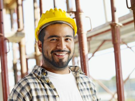 young man portrait: portrait of latin american construction worker, looking at camera Stock Photo