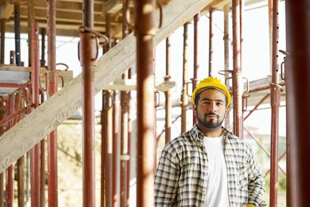 Portrait of latin american construction worker looking at camera  photo