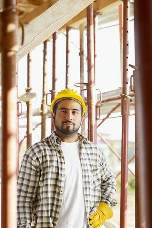 scaffold: latin american construction worker looking at camera.