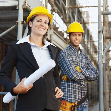female architect: Portrait of construction worker and female architect.