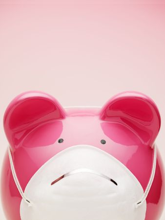 protective mask: piggy bank with protective mask. Copy space
