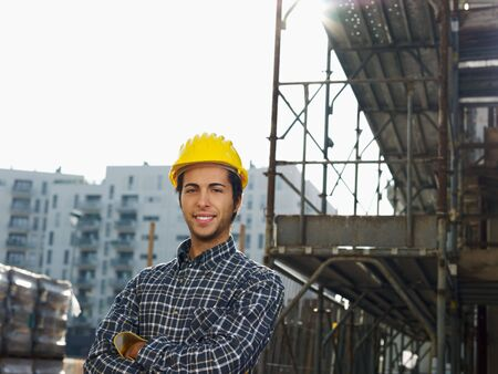 Construction worker with arms folded looking at camera. Copy space photo