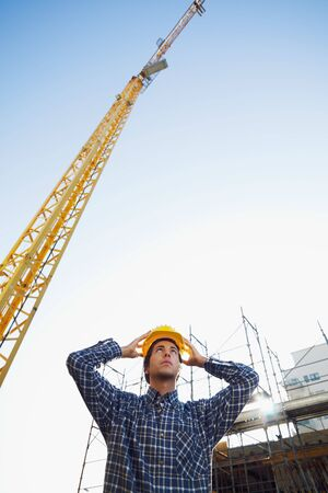 construction worker wearing hard hat. Low angle view, copy space photo
