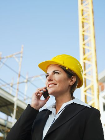 female engineer talking on mobile phone. Copy space photo